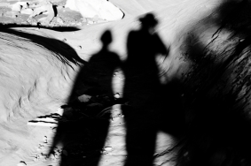Silhouettes at the Broken Arch, Arches National Park, Utah.
